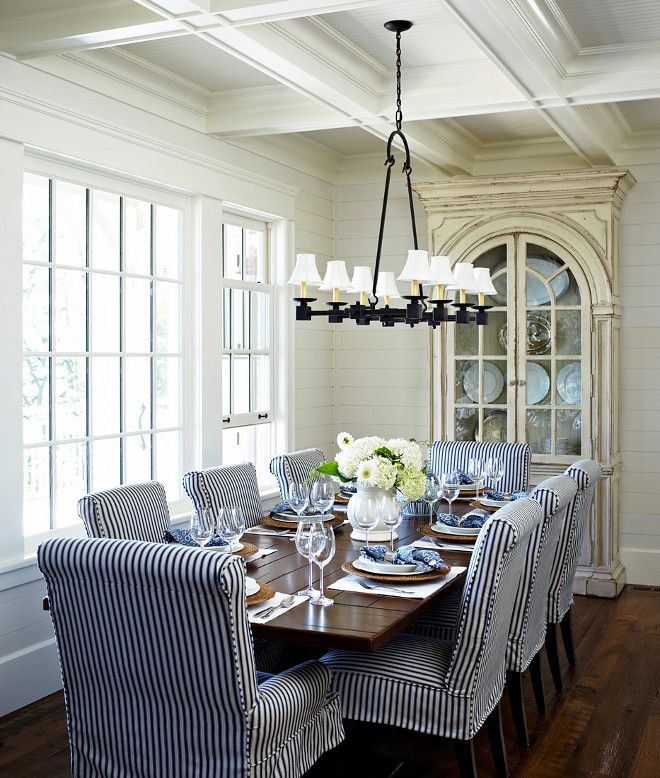 Coastal dining room with shiplap walls and coffered ...