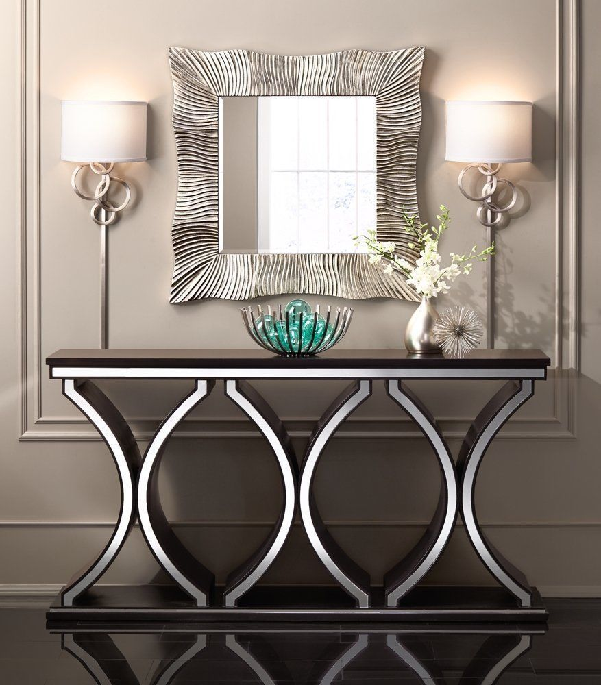 designer console tables. a rich chocolate brown finish enhances the distinctive design of this spacious contemporary console table that designer tables b