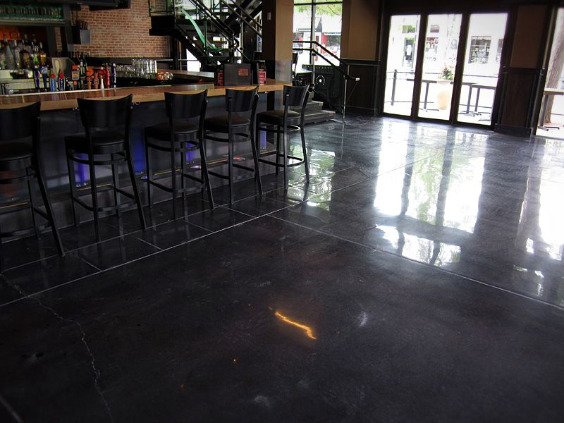 A Polished Concrete Floor With Black