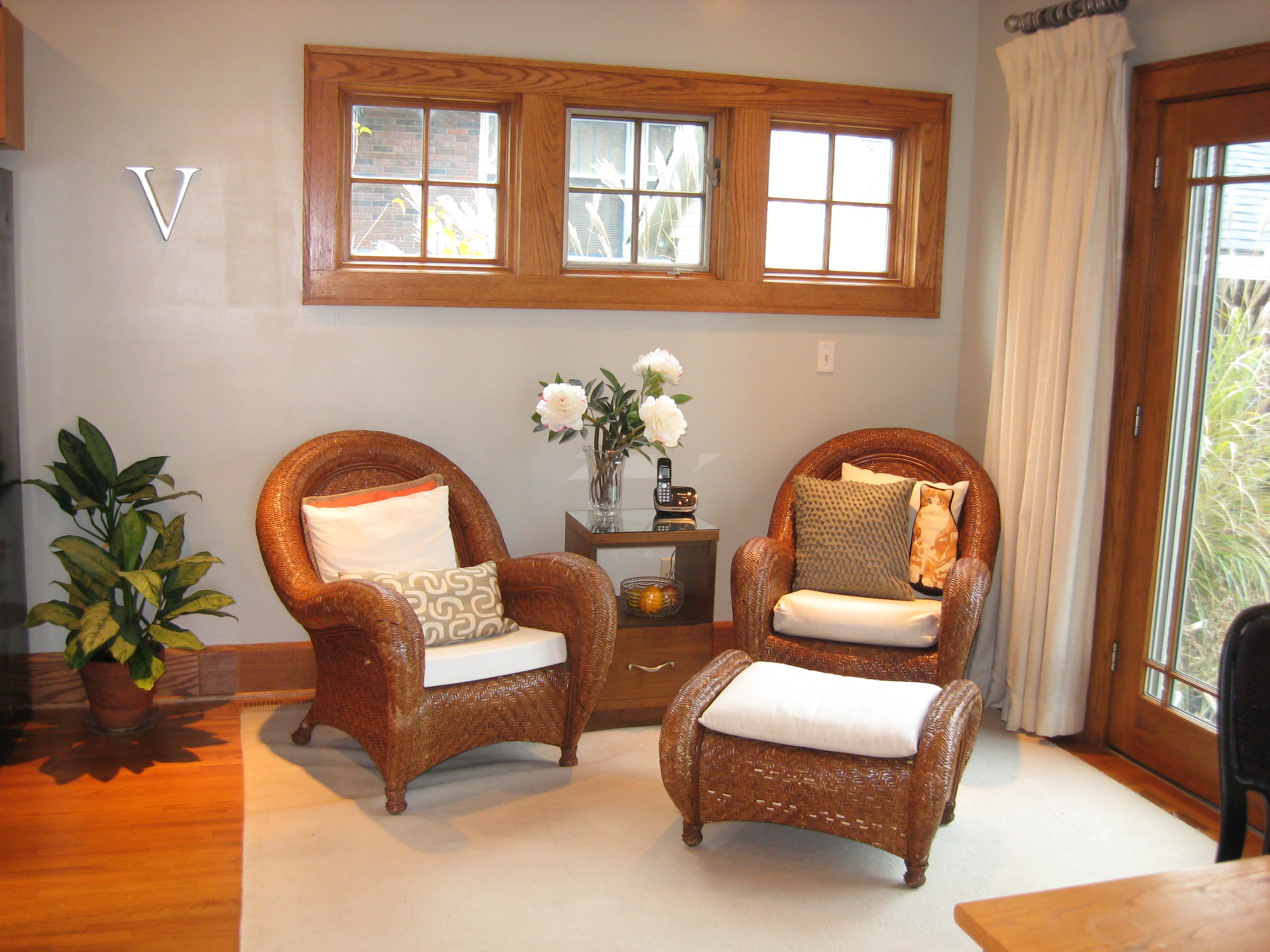 Warm Gray Walls Complement The Wood Tones Of This Home Office Seating Area.  Accent On