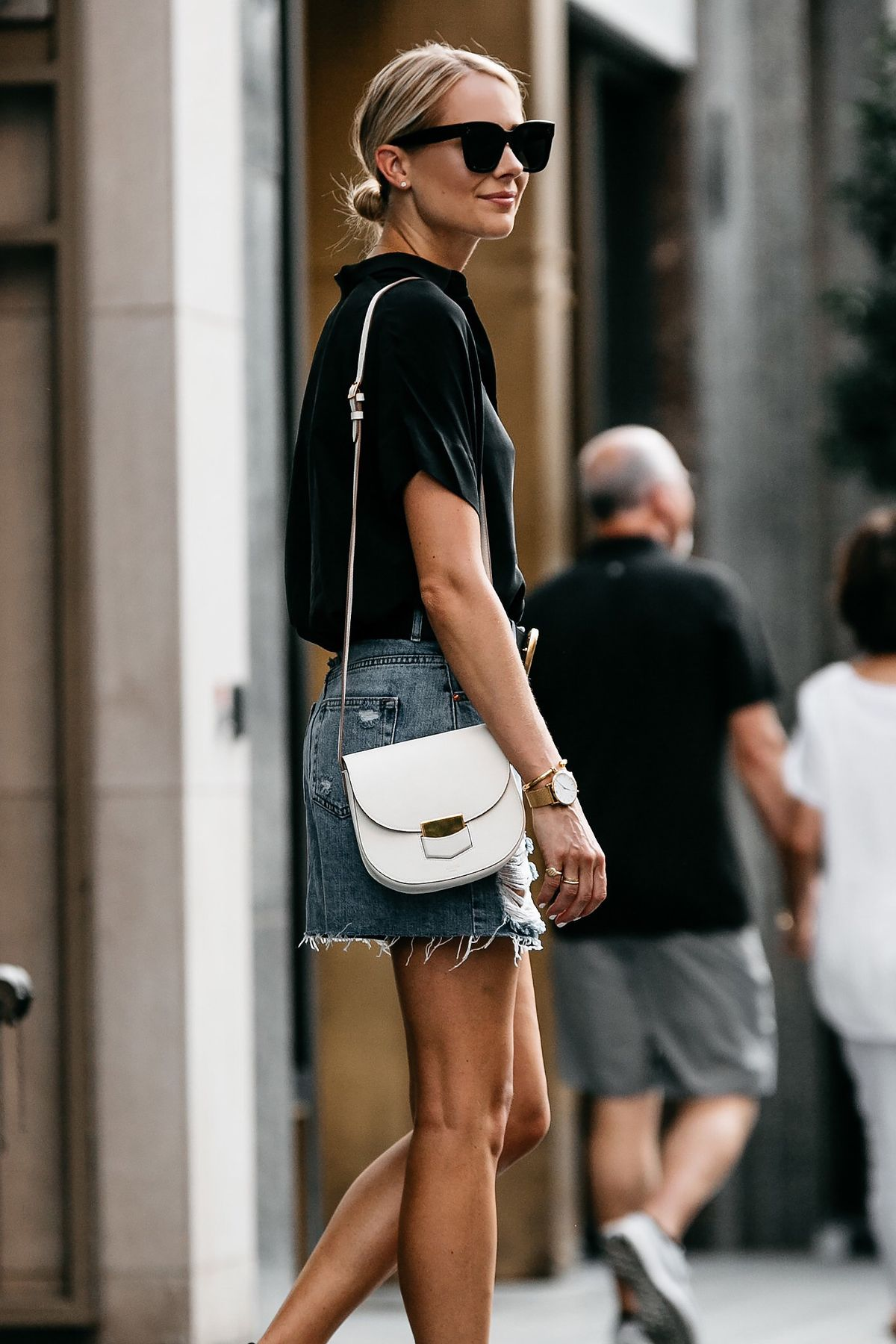 3cc2089152d Blonde Woman Wearing Everlane Black Short Sleeve Shirt Topshop Ripped Denim  Skirt Outfit Gucci Marmont Belt Celine Trotteur White Handbag Fashion  Jackson ...