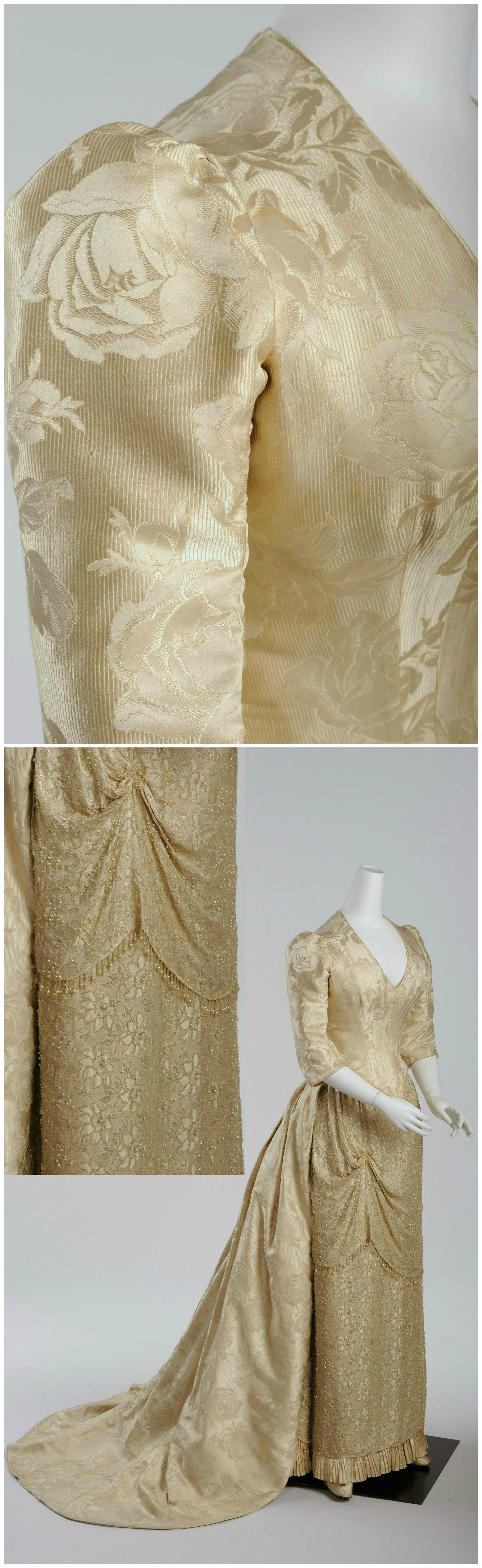 dress of silver silk damask with rose pattern,g. & e