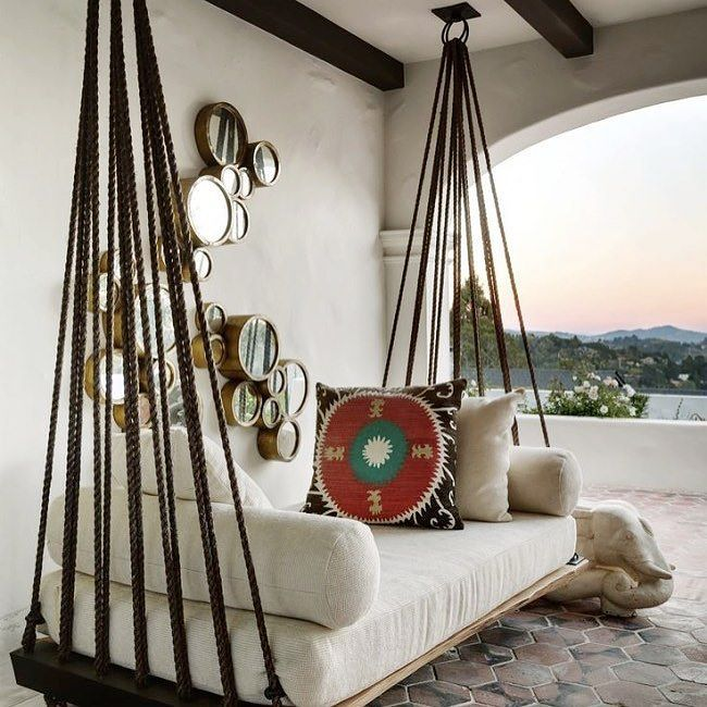 This is just about the coolest porch swing I have ever seen. #decorate