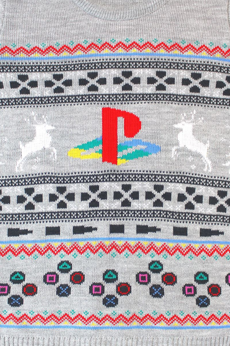 The original mean machine is back and ready to reclaim its retro gaming throne, with this Christmas Jumper. This Official Knitted Original PlayStation Christmas Jumper has the first Sony gaming machine's iconic d-pad, buttons and symbol, mixed up with Christmas motifs into a cocktail of festive retro gaming fashion!