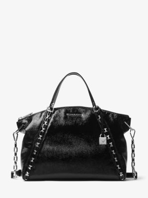 814e8a6019c6 Our Sadie satchel boasts rock 'n' roll appeal with edgy chain-link  detailing. Accented with our new minimalist lock charm, this luxe patent  leather style ...