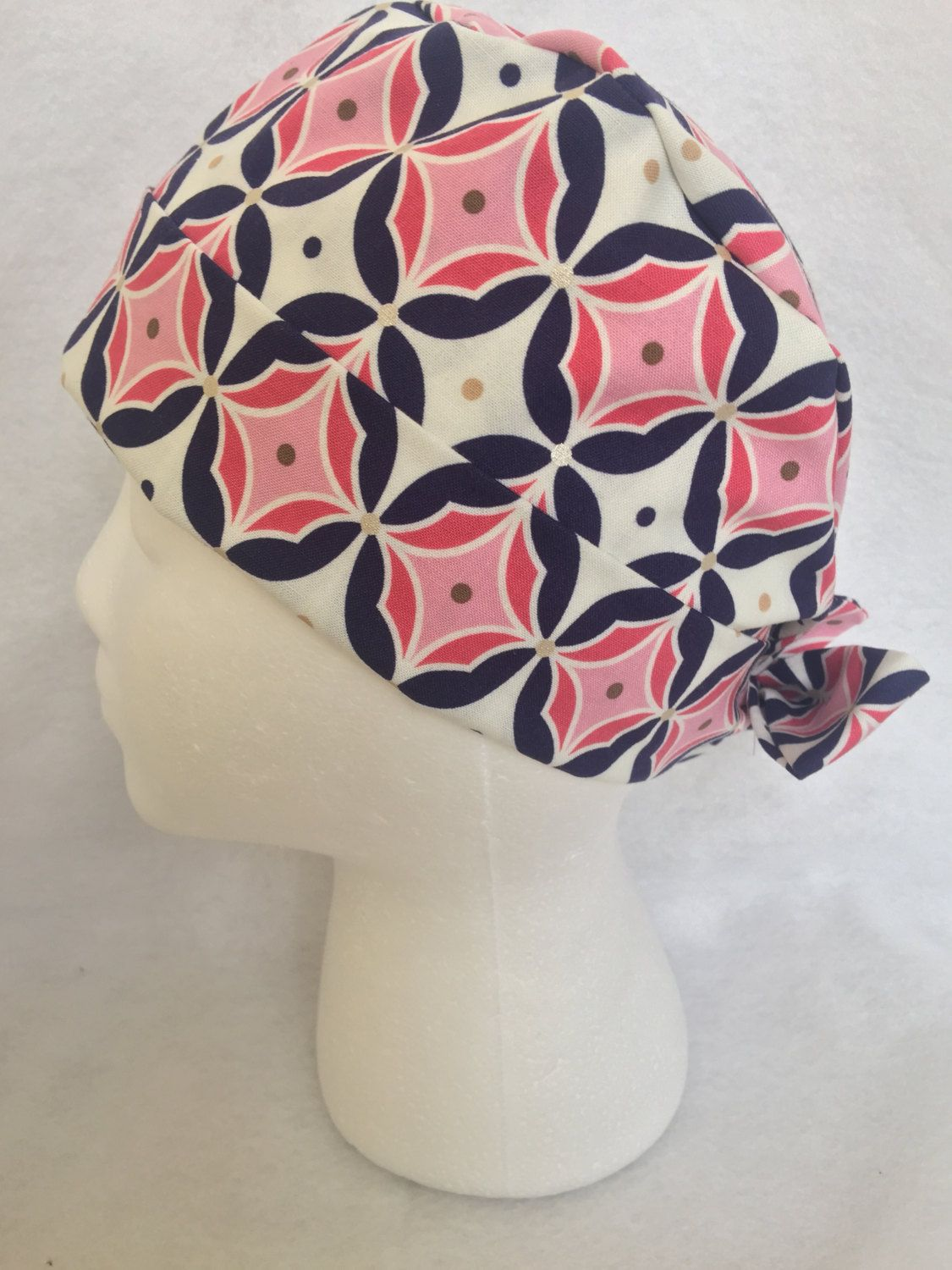 Pink geometric pattern with gold and silver accents pattern surgical cap. Pixie or chemo scrub hat. Tie back. Cute women surgical cap by SerendipityCaps on Etsy https://www.etsy.com/listing/216223371/pink-geometric-pattern-with-gold-and
