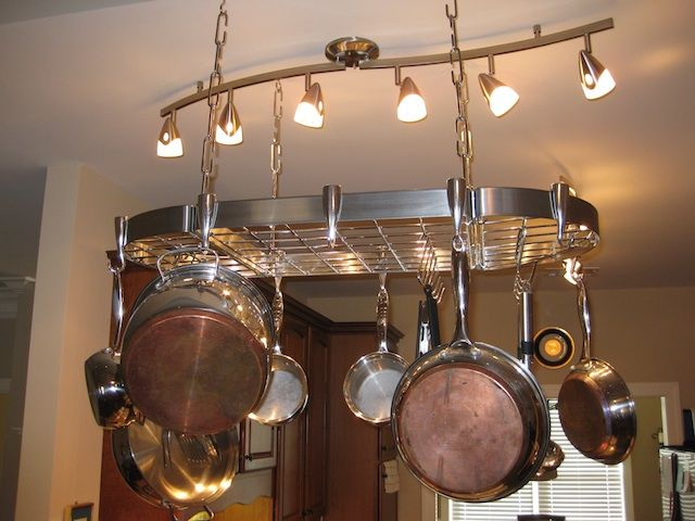 Pot Rack Hanging Above An Island In The Kitchen Kitchen Island