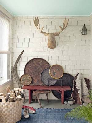 A basswood moose head contributes to the rustic ambience of this front porch. #decor