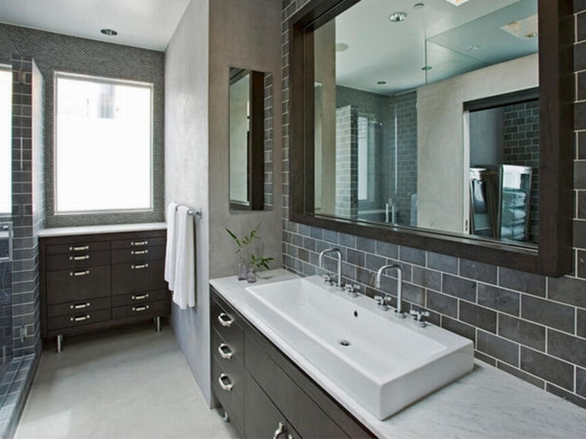 In this masculine modern bathroom designer randy for Monochromatic bathroom designs