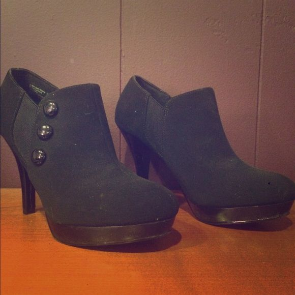 Suede Black Closed Toe Heels Mostly all suede material. However, near the ankle there is a portion that is elastic so that the shoe stretches and can got onto your foot. The heel is not very high at all, maybe 2-3 inches. Never worn! Price is negotiable. Shoes Ankle Boots & Booties