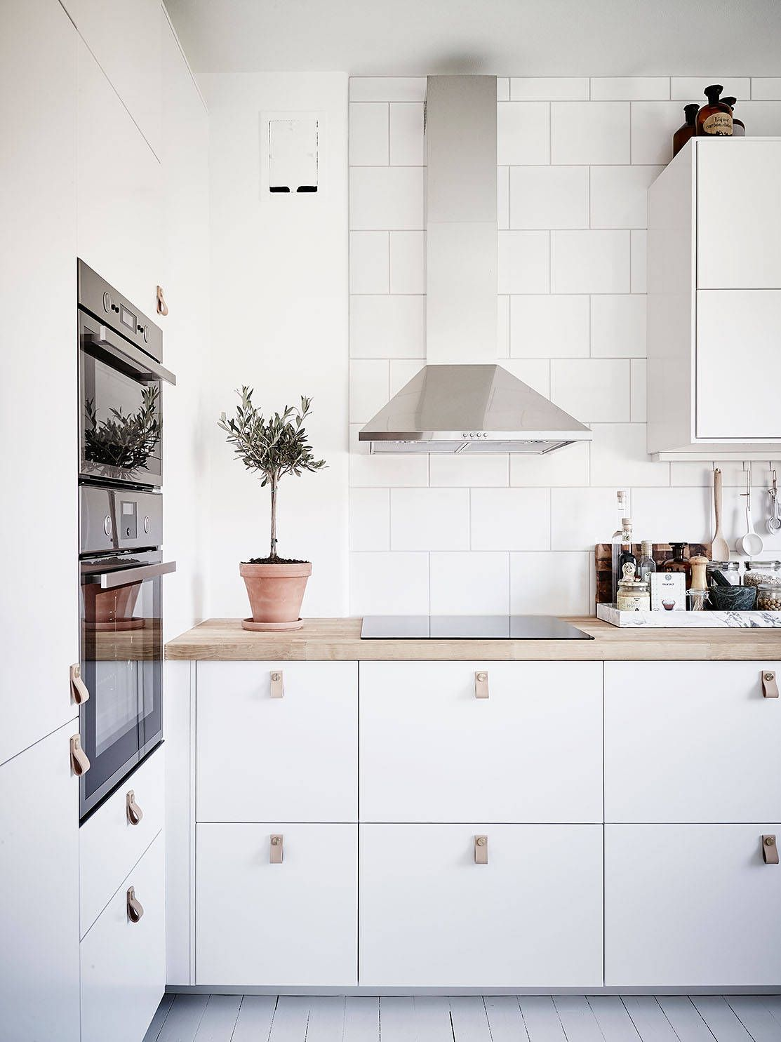 Scandinavian minimalist, white kitchen with wood