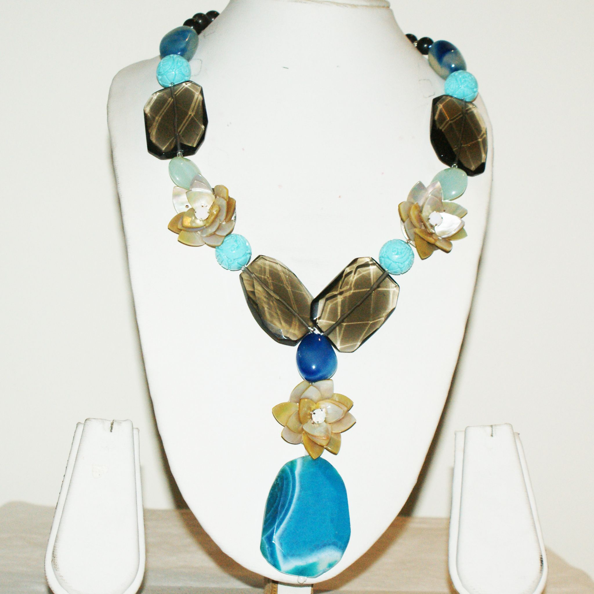 Raw blue Volcanic Stone Plate Pendant Necklace with contrasting embellishments of stones, flowers and crystal. Raw, yet intrinsically delicate!