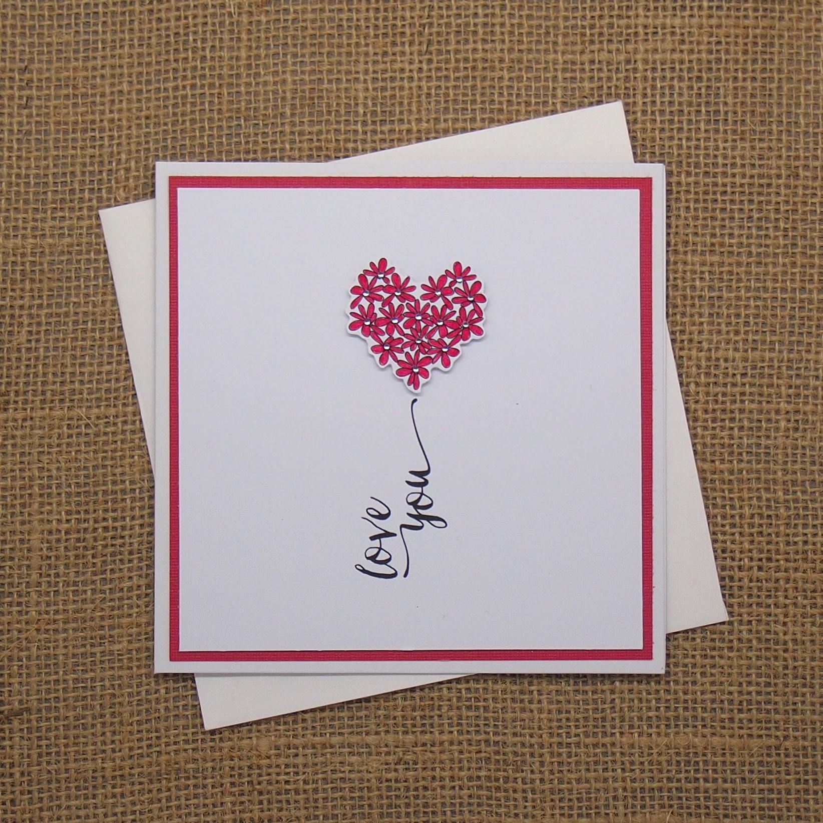 Handmade anniversary card with a heart of flowers and love you on