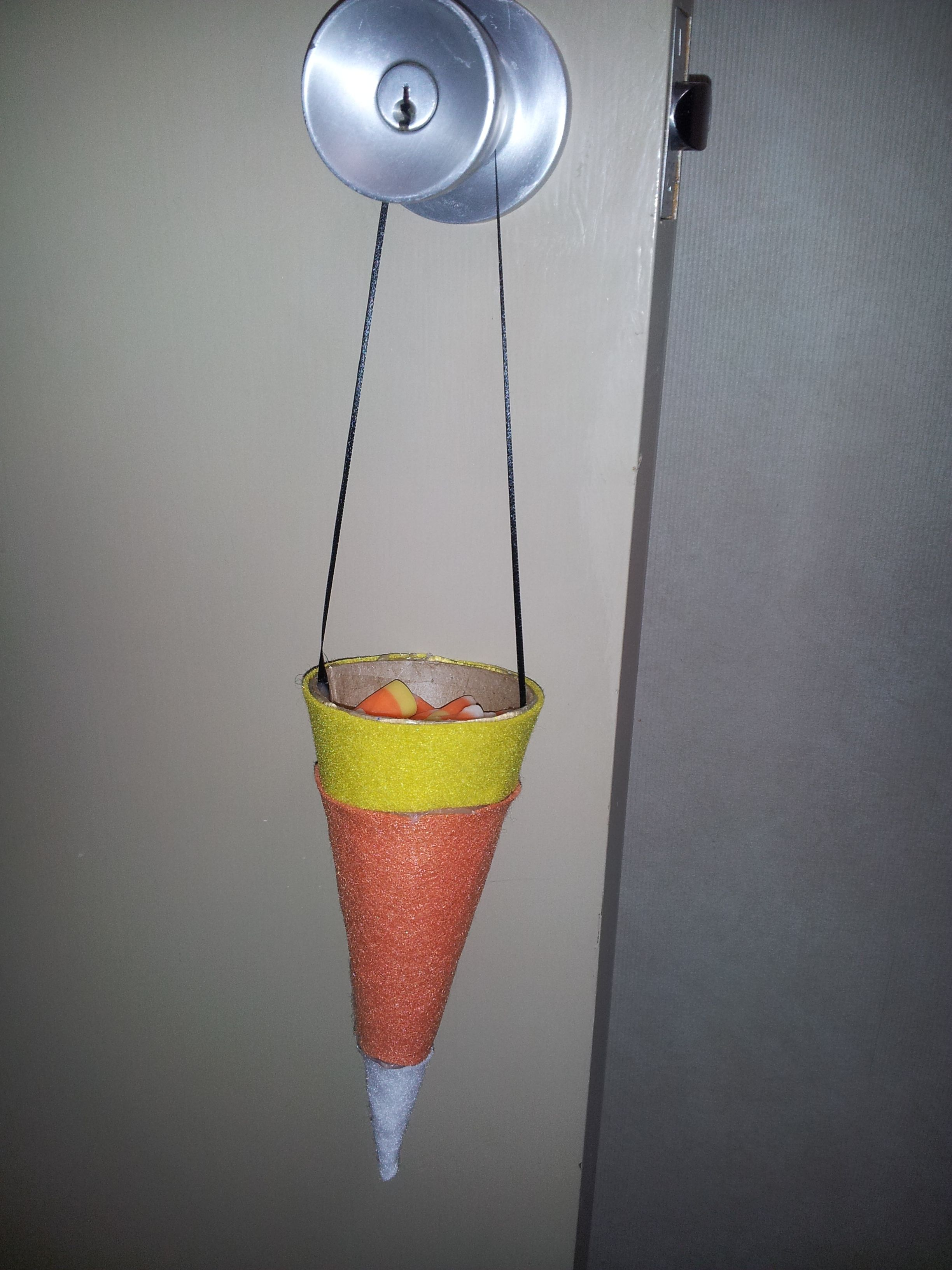 This is a cone I covered with felt to create a candy corn holder for Halloween.