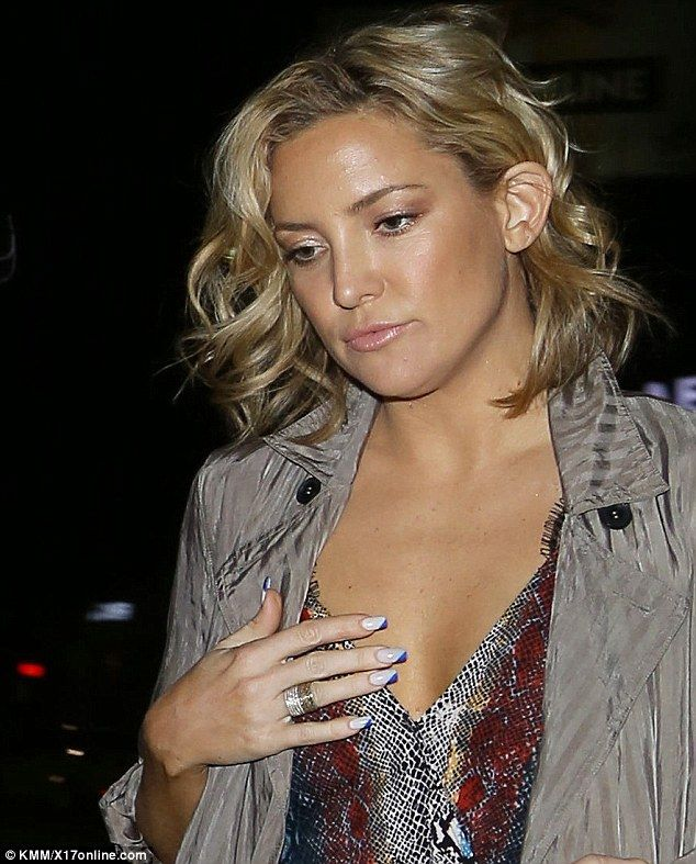 Kate Hudson dazzles in low-cut snake print jumpsuit for girls night ...
