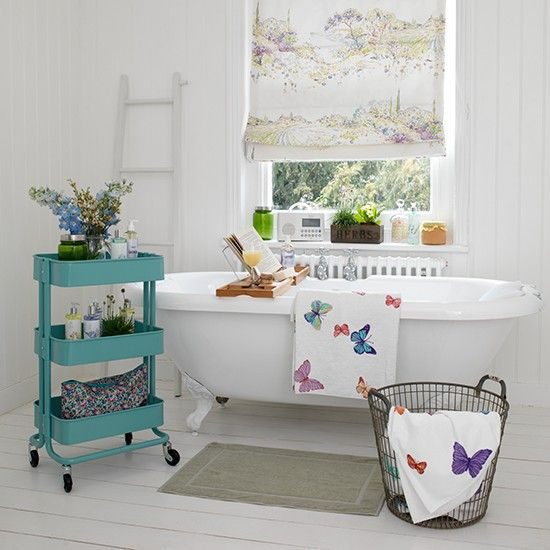 Vintage Style Bathroom Decorating Ideas white bathroom with roll-top bath and blue storage unit | vintage