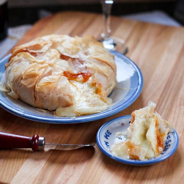 Pouring Out Of Crisp Flaky Phyllo Dough With Apricot Jam Brie
