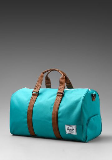 HERSCHEL SUPPLY CO. Novel Duffle in Teal Tan at Revolve Clothing - Free  Shipping! cf986ccb9b3ad