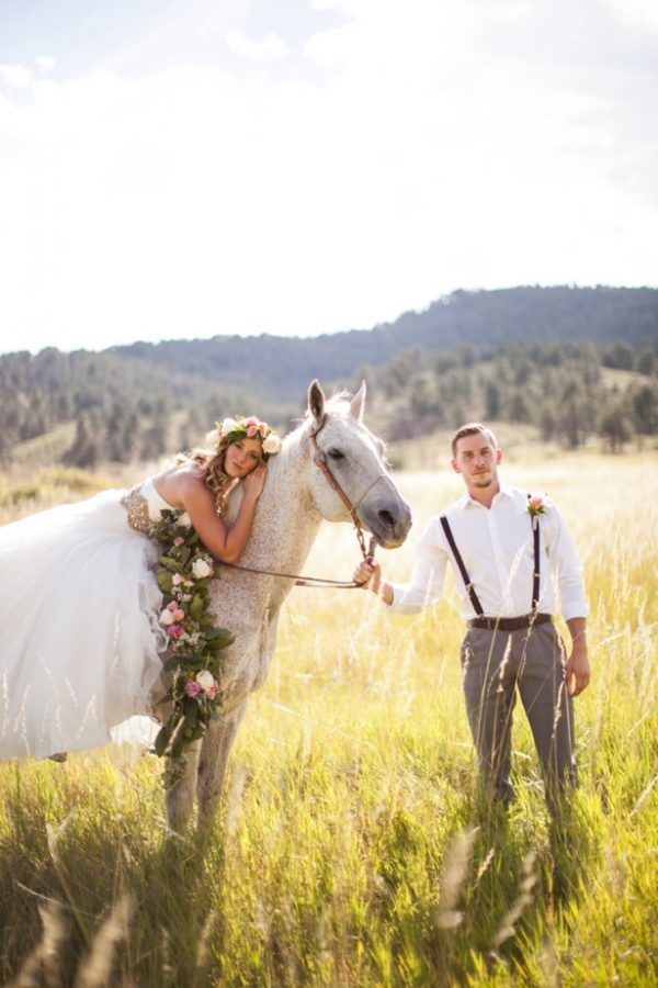bride and groom with horse colorado wedding styled shoot