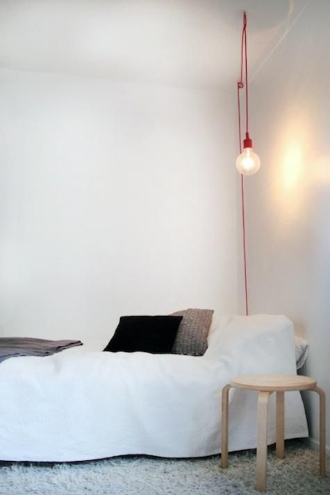 We Like This Simple Red Reading Light Strung From A Ceiling Hook Which Adds Festive Holiday Note