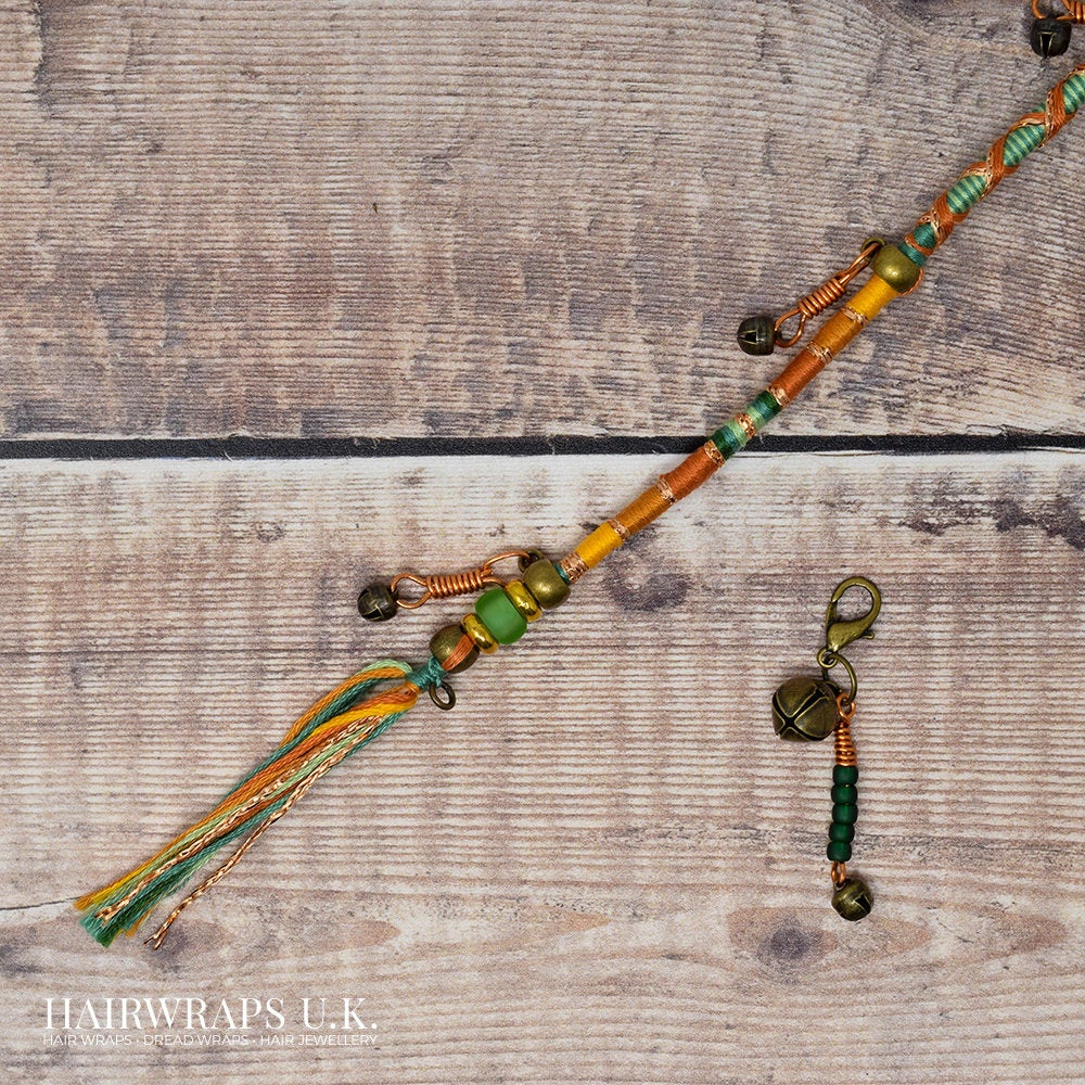 Green and orange hairwrap with bell charms Charmed hair