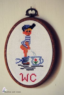 Cross stitched toilet-sign.
