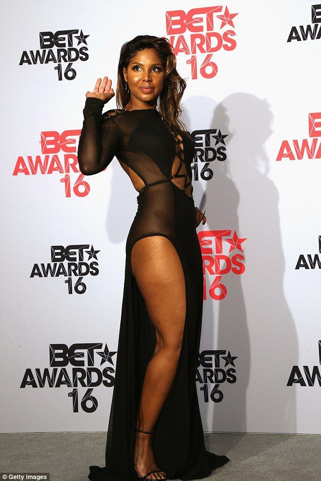 e43ce6a3295c1 Spicy  The 48-year-old songbird showed off her leg in this sheer dress with  a slit down the side