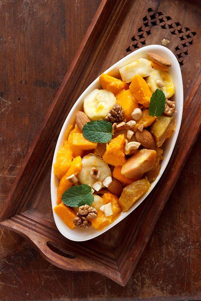 Fruit Salad Made With Sweet Tropical Fruits Mango Papaya Banana And Sapota Topped With Roasted Dry Fruits And Mi Fruit Salad Recipes Recipes Salad Recipes