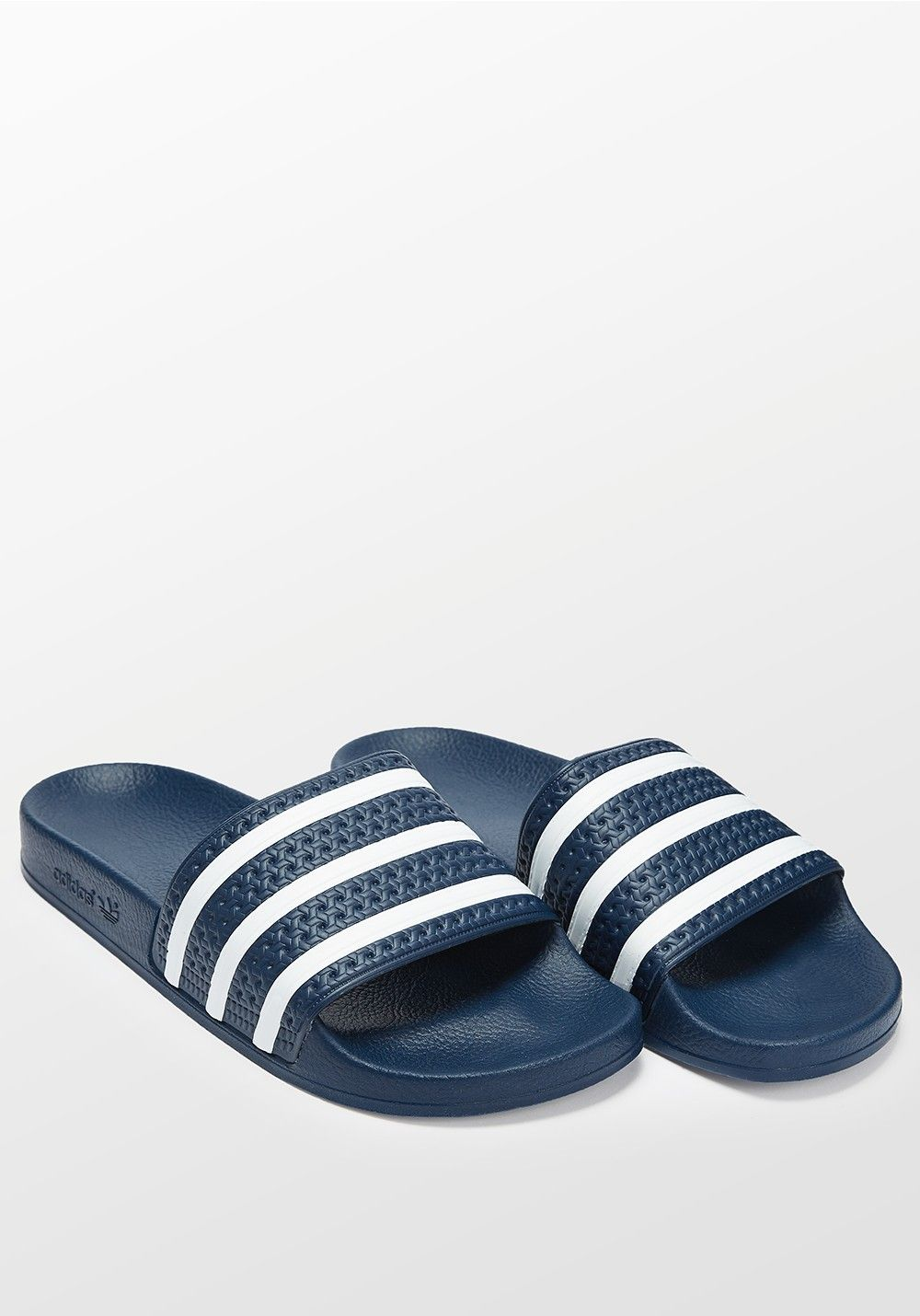0b42e9346549 Adidas Adilette navy blue and white slides