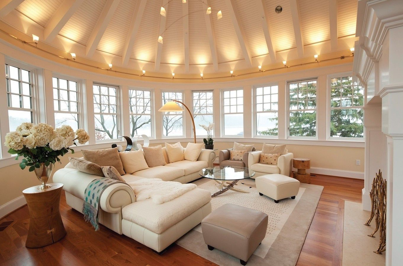 Sunroom With Fireplace Designs A Second Floor Sunroom Features A Semi Circular Vaulted Ceiling