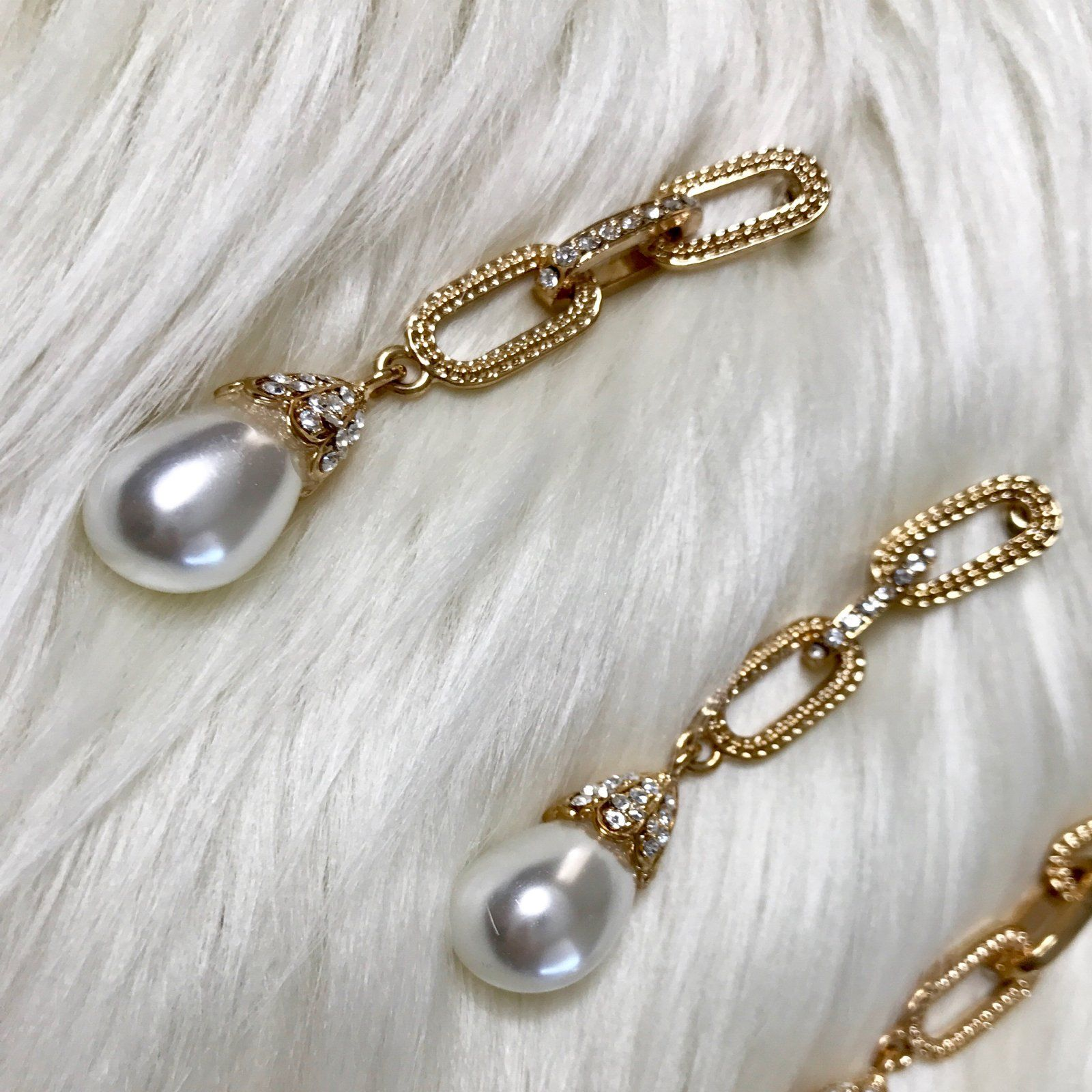 Gold chain drop earrings with pearls at each end the perfect pair
