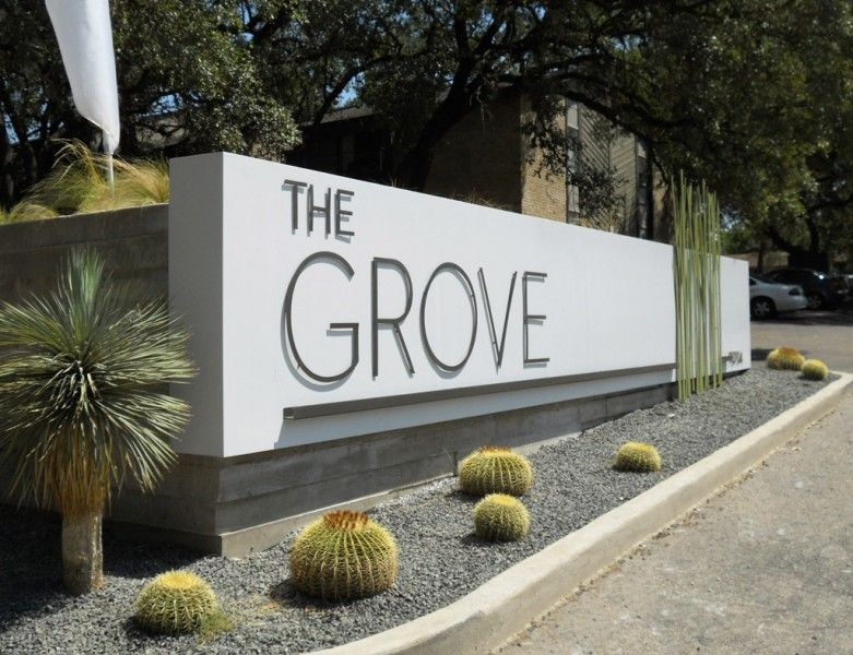 Apartment Subdivision Signage Light Grey Concrete Modern Plain With Cactus Palm Plant Nice Low Maintenance