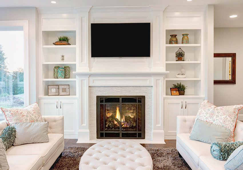 living room built in book shelves with fireplace