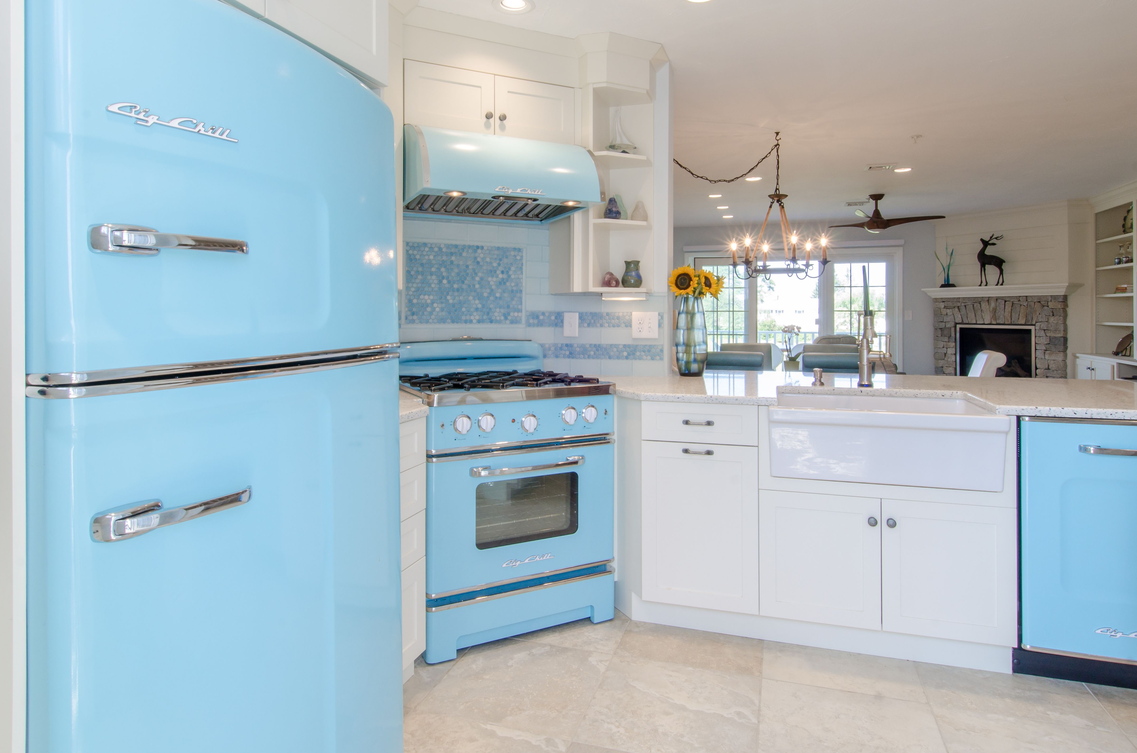 White cabinetry, curava recycled glass countertop, tile backsplash ...