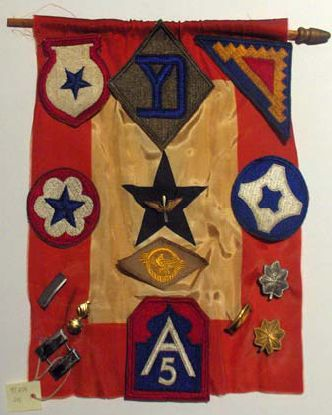 WWII service flag with applied insignia and medals. Wright Museum Collection, 1997 gift of Raymond Johnson Jr.