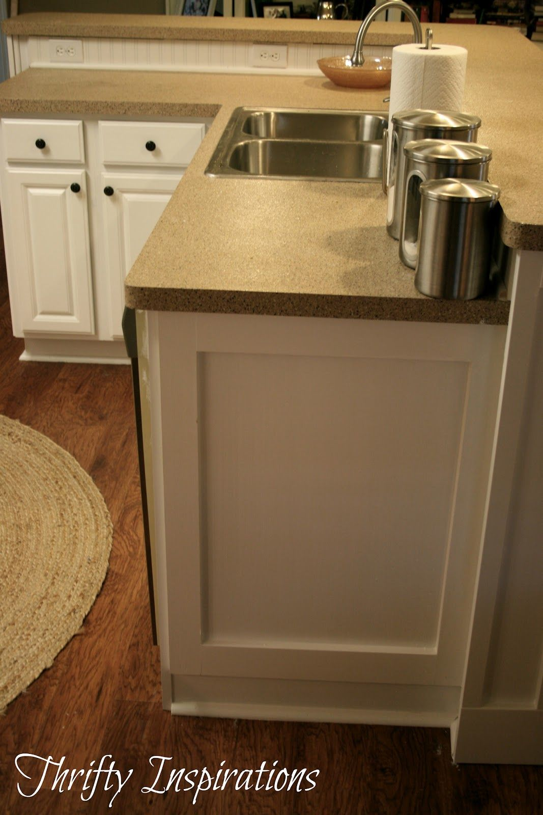 Pure white cabinet transformations redo. Love the moulding she put ...