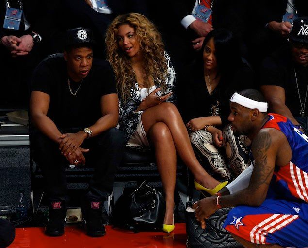 Jay-Z wearing Lanvin Men's Chain Embroidery Necklace and Nike Air Force 180  Mid Sneakers