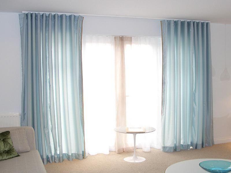 stylish curtains on ceiling track decor