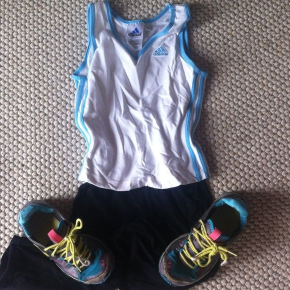 Black and white Adidas workout tank top running Size medium Adidas blue and white workout top. Fits like an xs hence why it is listed as such. Tank style with v neck. Questions? Please ask! Adidas Tops Tank Tops