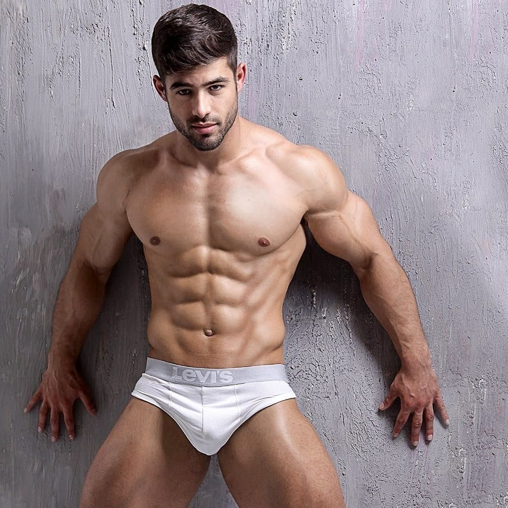 Muscular and sexy body of young sporty man hunk in jeans shirt