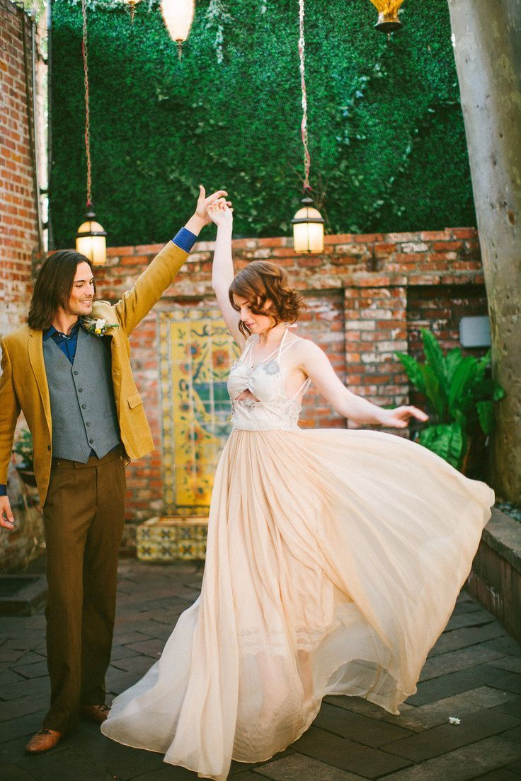 Peach wedding dress and groom in yellow mustard suit | itakeyou.co.uk