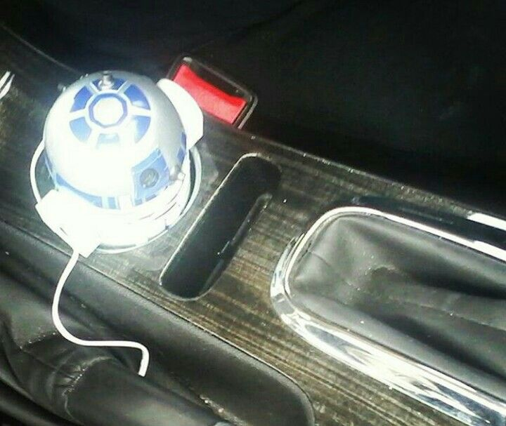 R2d2 car phone charger. Beeps and turns its head.