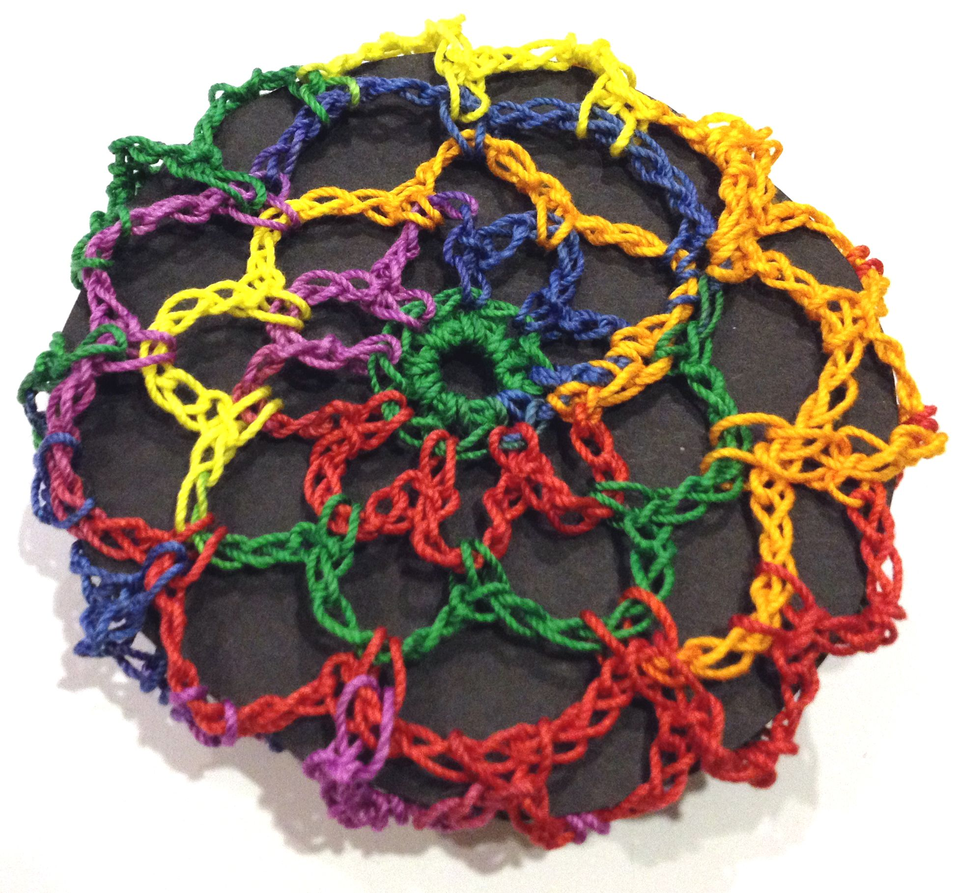 Hair bun cover crocheted in a hair net style. Color= Rainbow multi ...