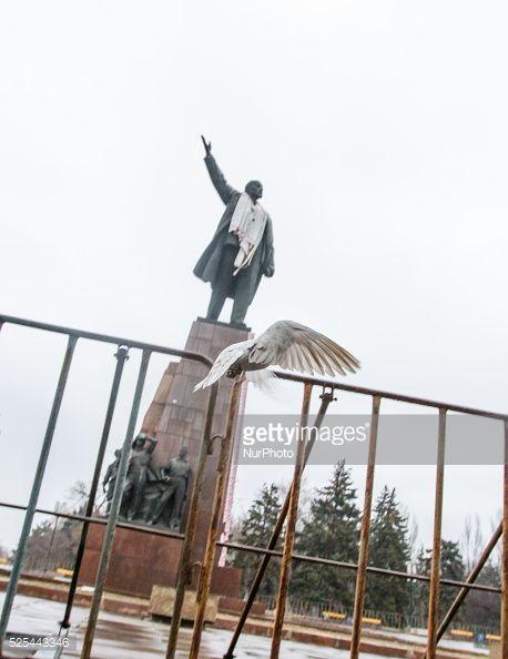 A statue of Vladimir Lenin is seen as a pigeon flies by.... #zaporizhzhya: A statue of Vladimir Lenin is seen as a pigeon… #zaporizhzhya