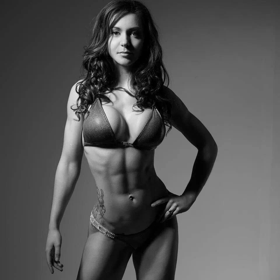 Young sexy fitness woman posing in gym stock image