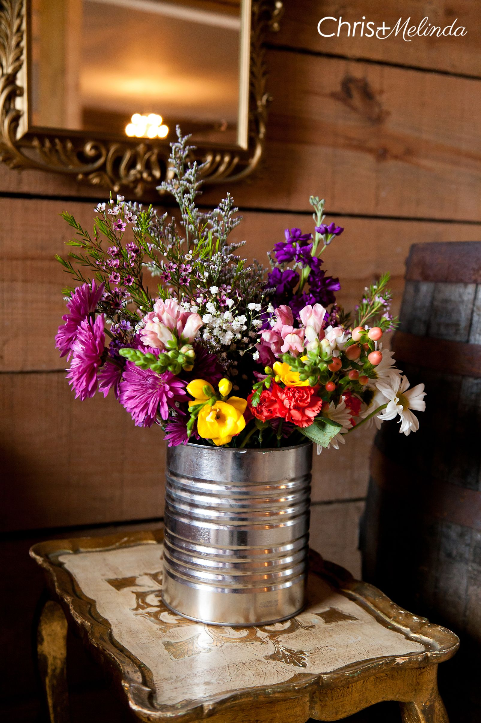 Wedding flower decoration images  Rustic flower arrangement in a tin can rustic wedding flowers