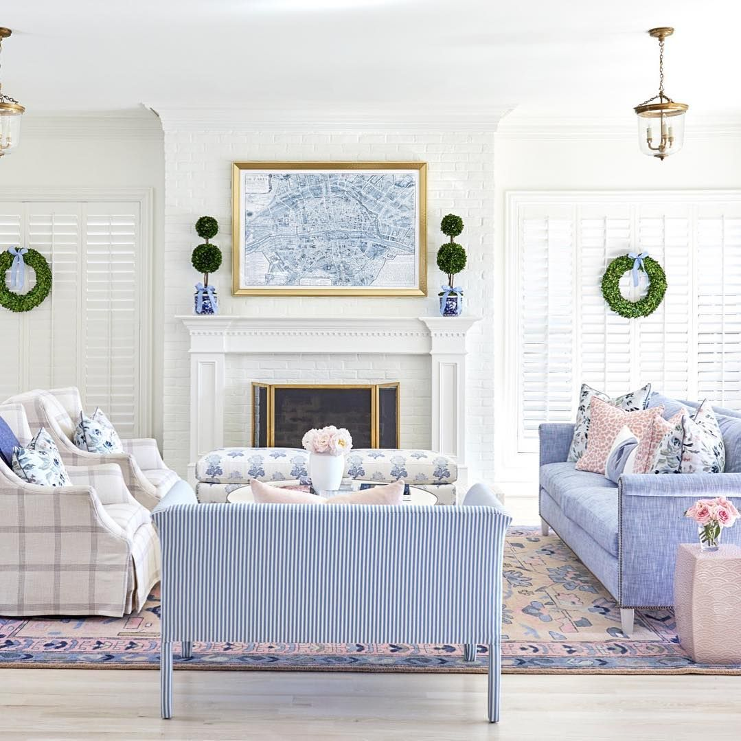 Here's the first look into our newly remodeled living room! We raised the floor to create a seamless flow from the kitchen so family time can spill into here when meals are done. Our Jolie Rug is the foundation that ties everything together with touches of blue, blush and white throughout. {Shop rug and pillows at CaitlinWilson.com} #cwspaces#caitlinwilsondesign Construction by: @fifercustomhomes #havenlylivingroom
