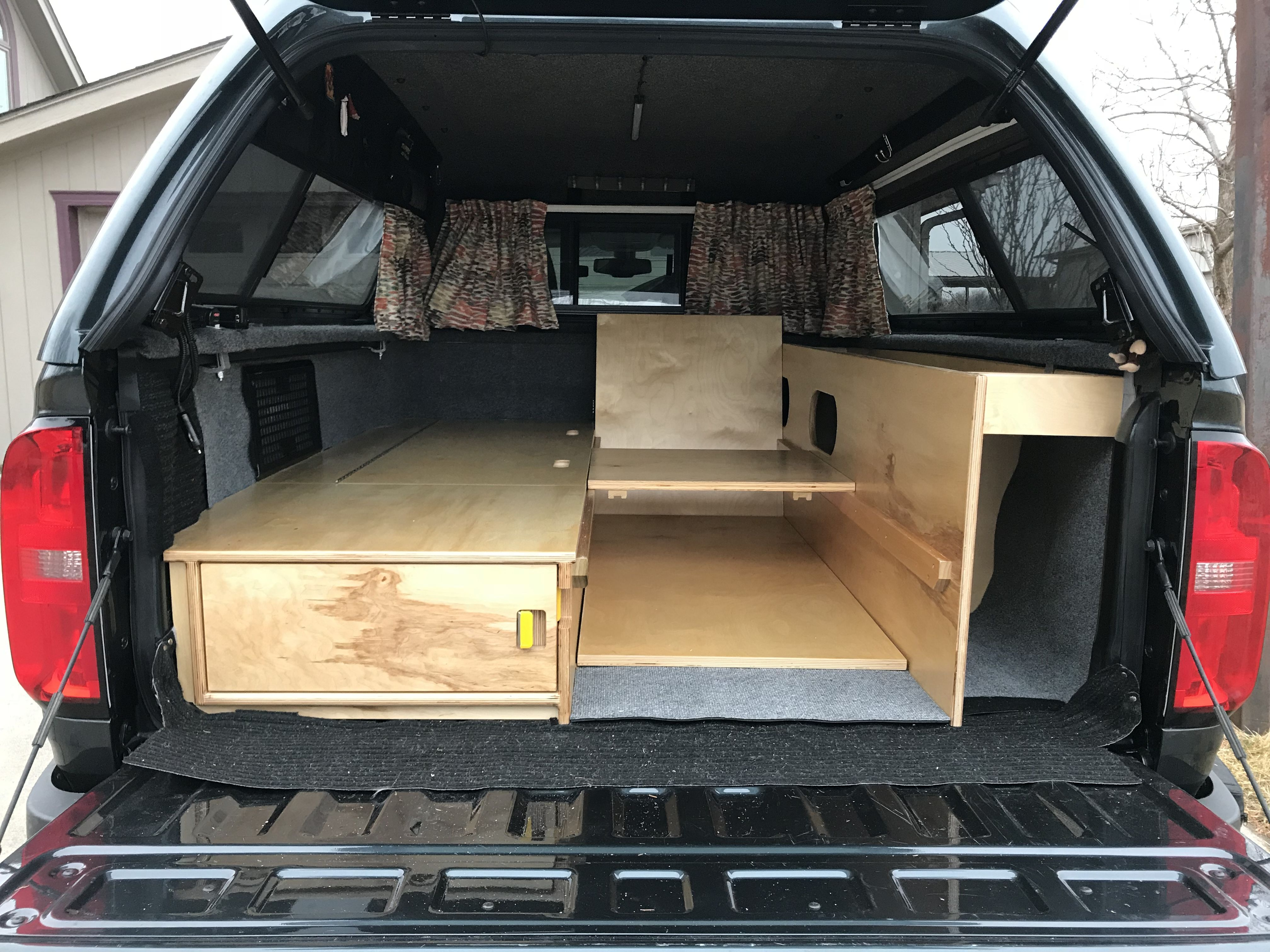 Truck conversion with side bed and chair. Truck bed