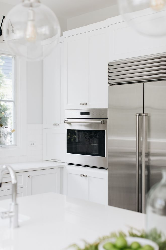 Kitchen Crisp white cabinets with stainless steel ...