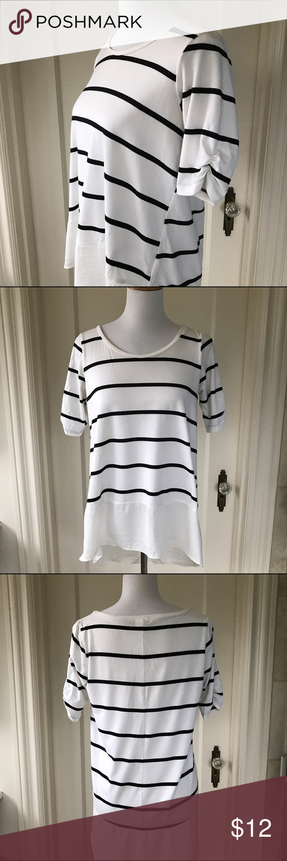 Lili's Closet Striped Peplum Tee With with Black stripes. Ruching on sleeves. Light piling under arms, not visible when worn. 76% Rayon. 18% Polyester. 6% Spandex. Peplum 100% Polyester. Machine washable. Size S, could fit Medium. Anthropologie Tops Tees - Short Sleeve